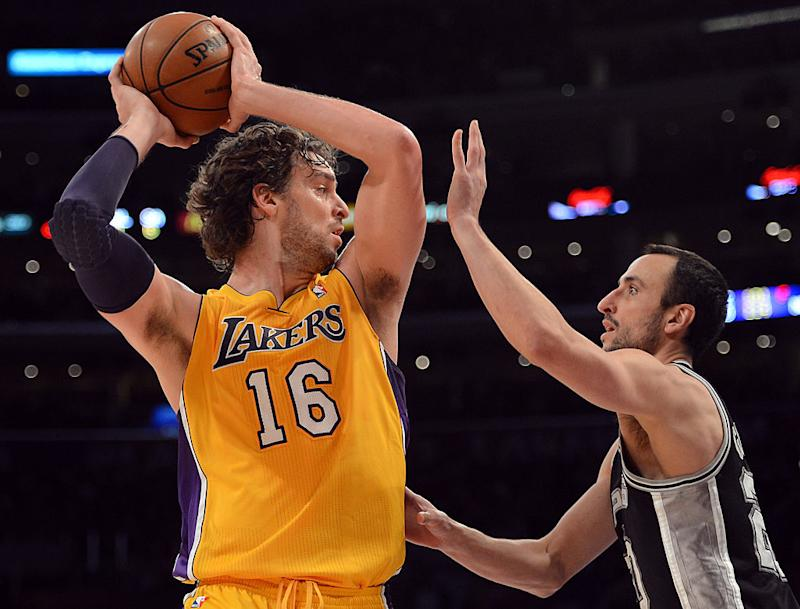 Pau Gasol and Manu Ginobili met in three playoff series and were teammates four four more. (Getty Images)