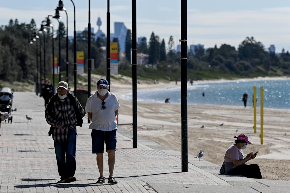 Members of the public exercise at Brighton-Le-Sands beach in Sydney, Wednesday. Source: AAP