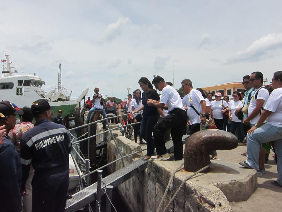 Rep. Leni Robredo being escorted onto a boat that would take them to the site where Sec. Jesse Robredo's plane went down (photo courtesy of Panch Alvarez)