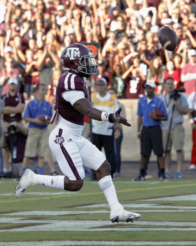 Texas A&M running back Ben Malena (1) scores on a three yard run against SMU during the first quarter of an NCAA college football game Saturday, Sept. 14, 2013, in College Station, Texas. (AP Photo/Bob Levey)