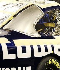 The C-post is the silver area under repair on Jimmie Johnson's car
