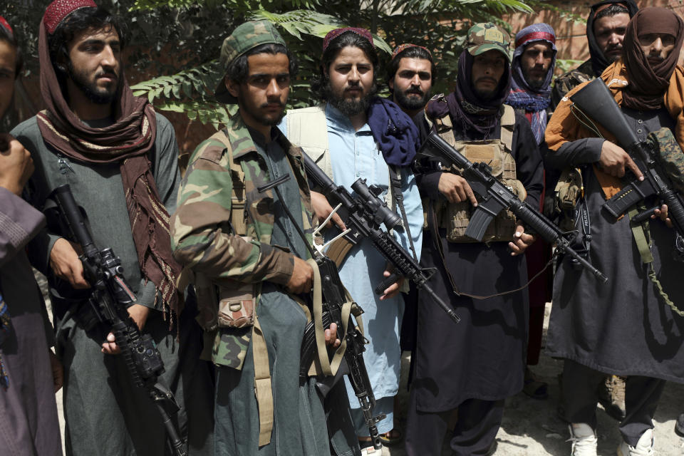 """Taliban fighters pose for photograph in Wazir Akbar Khan in the city of Kabul, Afghanistan, Wednesday, Aug. 18, 2021. The Taliban declared an """"amnesty"""" across Afghanistan and urged women to join their government Tuesday, seeking to convince a wary population that they have changed a day after deadly chaos gripped the main airport as desperate crowds tried to flee the country. (AP Photo/Rahmat Gul)"""