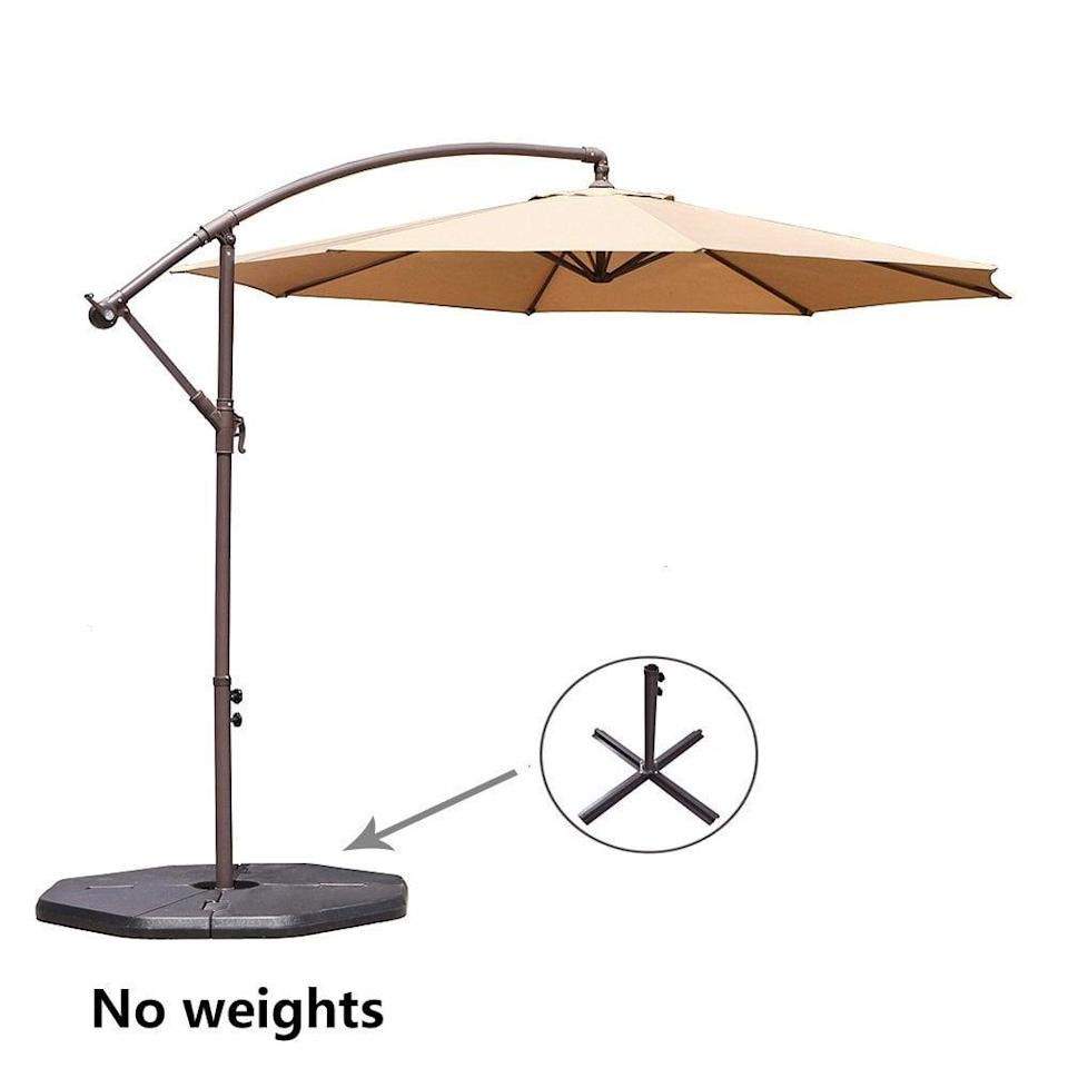 <p>It's summer. It's hot. You need an umbrella. This <span>Le Papillon 10-ft Offset Hanging Patio Umbrella</span> ($150) is huge, which is why we like it so much. </p>