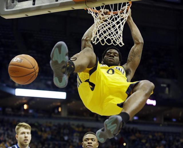 Marquette's Jamil Wilson dunks during the first half of an NCAA college basketball game against Seton Hall, Saturday, Jan. 11, 2014, in Milwaukee. (AP Photo/Morry Gash)