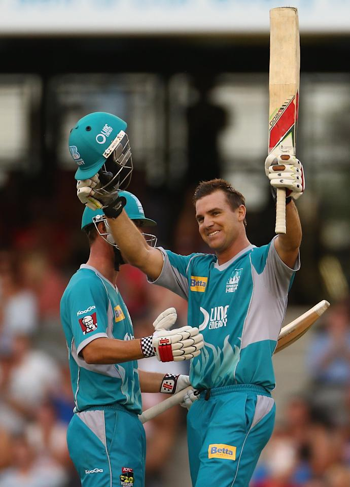 MELBOURNE, AUSTRALIA - JANUARY 15:  Luke Pomersbach of the Heat celebrates with Chris Lynn after scoring his century during the Big Bash League Semi-Final match between the Melbourne Renegades and the Brisbane Heat at Etihad Stadium on January 15, 2013 in Melbourne, Australia.  (Photo by Robert Cianflone/Getty Images)