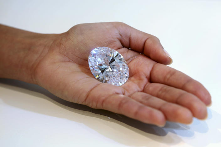 A 118-carat white diamond is on display at Sotheby's, a New York auction house, Wednesday, Sept. 4, 2013 in New York. The oval stone will be auctioned off in Hong Kong on Oct. 7 and has a pre-sale estimate of $28 million to $35 million. The current record for any white diamond is $26.7 million. (AP Photo/Mary Altaffer)