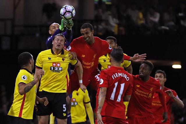 Watford's goalkeeper Heurelho Gomes punches the ball clear during the English Premier League football match between Watford and Liverpool at Vicarage Road Stadium in Watford, north of London on May 1, 2017 (AFP Photo/Adrian DENNIS)