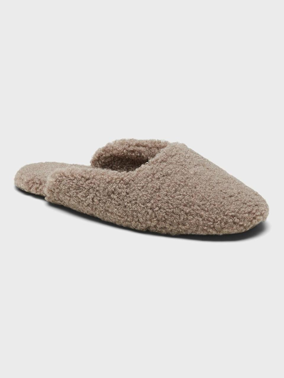 <p>Keep your feet cozy in these chic <span>Sherpa Indoor Slippers</span> ($61, originally $68).</p>