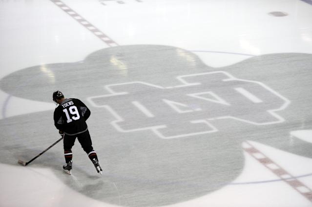 Chicago Blackhawks' Jonathan Toews skates at the teams NHL hockey training camp on the campus of the University of Notre Dame in South Bend, Ind., Thursday, Sept. 12, 2013. (AP Photo/Joe Raymond)