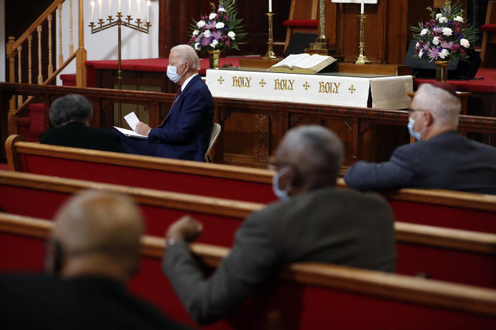 FILE - In this Monday, June 1, 2020, file photo, Democratic presidential candidate, former Vice President Joe Biden listens as clergy members and community activists speak during a visit to Bethel AME Church in Wilmington, Del. Democrats are betting on Biden's evident comfort with faith as a powerful point of contrast in his battle against President Donald Trump. (AP Photo/Andrew Harnik, File)