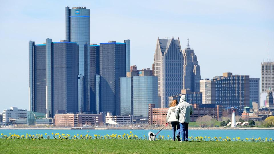 """""""Detroit, Michigan, USA - April 4, 2012: People walking their dog on a sunny day on Belle Isle, a city park in the Detroit River."""