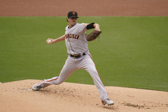 San Francisco Giants starting pitcher Kevin Gausman works against a San Diego Padres batter during the first inning of a baseball game Sunday, May 2, 2021, in San Diego. (AP Photo/Gregory Bull)