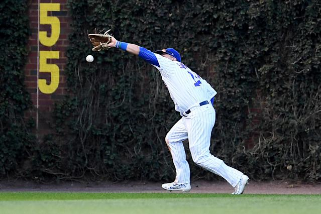 Kyle Schwarber makes an error in Game 3 of the NLDS at Wrigley Field. (Photo by Stacy Revere/Getty Images)