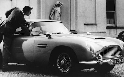 Sean Connery as James Bond in Goldfinger, with the Aston Martin DB5 - Credit: Cine Text / Allstar/ Sportsphoto Agency