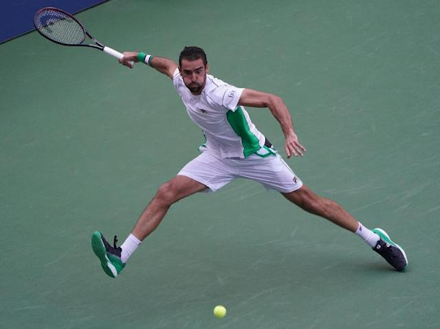 Marin Cilic on the way to a US Open fourth-round victory over David Goffin on Monday. (AFP Photo/kena betancur)