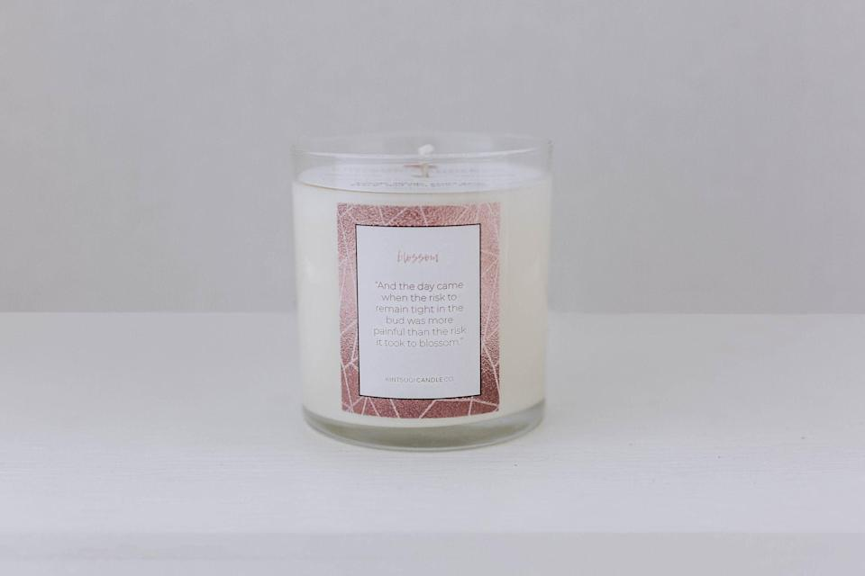"""<p><strong>blossom</strong></p><p>kintsugicandleco.com</p><p><strong>$22.00</strong></p><p><a href=""""https://www.kintsugicandleco.com/candles/blossom"""" rel=""""nofollow noopener"""" target=""""_blank"""" data-ylk=""""slk:Shop Now"""" class=""""link rapid-noclick-resp"""">Shop Now</a></p><p>Allison Jones founded Kintsugi after being diagnosed with a brain tumor and finding solace in aromatherapy during her treatment. The company is named after the Japanese art of repairing cracks with gold fill, thereby making once """"broken"""" items more valuable—and beautiful. </p>"""