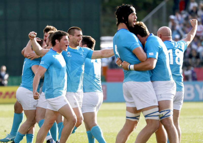 Uruguay's players celebrate after winning over Fiji during the Rugby World Cup Pool D match in Kamaishi, northeastern Japan, Wednesday, Sept. 25, 2019. (Naoya Osato/Kyodo News via AP)