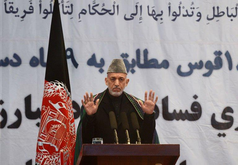 Hamid Karzai speaks at an 'Anti-Corruption' event at Amani High School in Kabul on December 22, 2012
