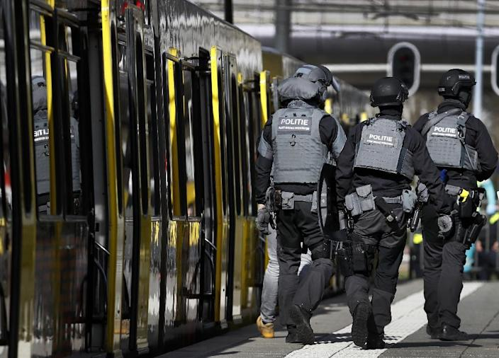 Armed police and emergency services swarmed the scene after the shooting in the city of Utrecht (AFP Photo/Robin van Lonkhuijsen)