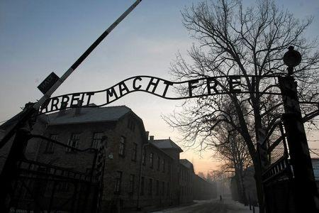 "The Nazi slogan ""Arbeit macht frei"" (Work sets you free) is pictured on the gate of the former Nazi German concentration and extermination camp Auschwitz-Birkenau in Oswiecim"