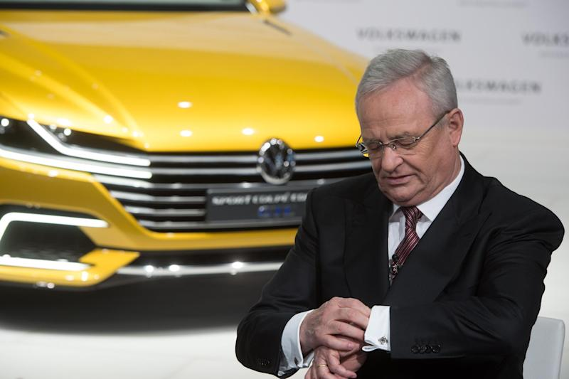 In this March 12, 2015 picture Volkswagen CEO, Martin Winterkorn, looks at his watch. during the anual press conference of Volkswagen AG in Berlin. Volkswagen CEO Martin Winterkorn said Wednesday, Sept. 23, 2015 he is stepping down. ( Jochen Luebke/dpa via AP)