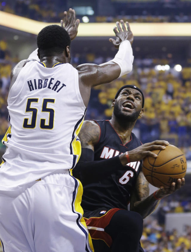 Miami Heat forward LeBron James (6) looks to shoot over Indiana Pacers center Roy Hibbert (55) during the first half of Game 5 of the NBA basketball Eastern Conference finals in Indianapolis, Wednesday, May 28, 2014. (AP Photo/Michael Conroy)