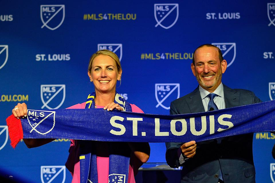 Aug 20, 2019; St. Louis, MO, USA; MLS commissioner Don Garber places poses for a photo with ownership group leader Carolyn Kindle Betz after announcing an expansion team for St. Louis at The Palladium. Mandatory Credit: Jeff Curry-USA TODAY Sports