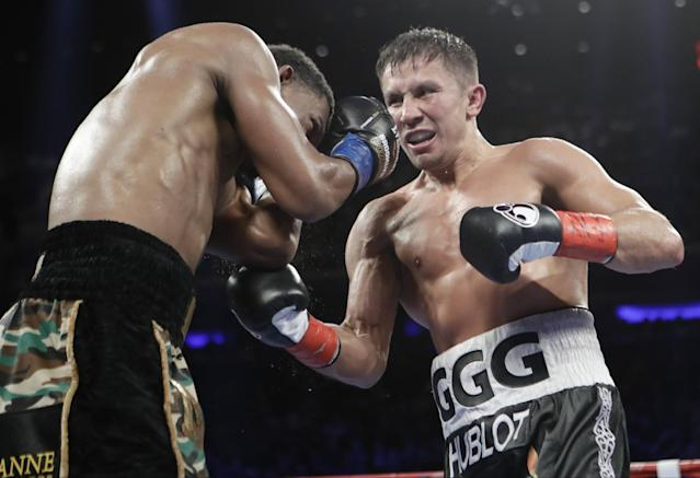 Gennady Golovkin, right, lands against Daniel Jacobs during the 11th round Saturday night. (AP)
