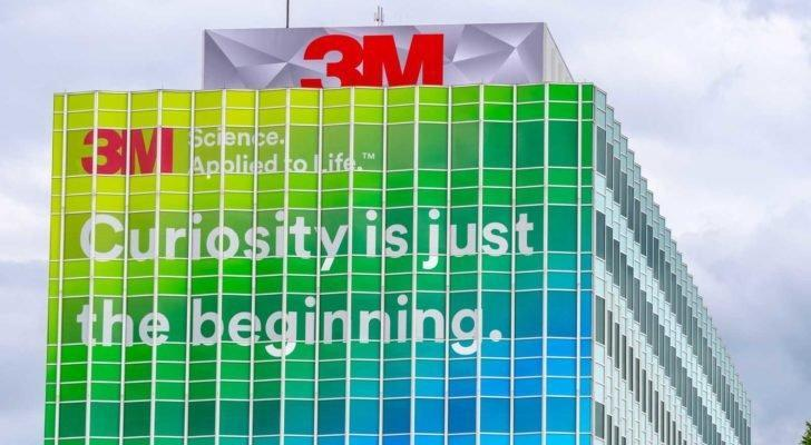 "3M (MMM) building with logo and words on the side reading ""Curiosity is just the beginning."""
