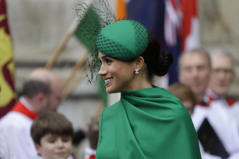 Britain's Meghan the Duchess of Sussex receives flowers as she leaves after attending the annual Commonwealth Day service at Westminster Abbey in London, Monday, March 9, 2020. The annual service, organised by the Royal Commonwealth Society, is the largest annual inter-faith gathering in the United Kingdom. (AP Photo/Kirsty Wigglesworth)