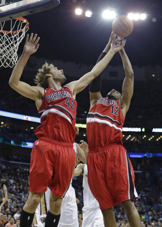 Portland Trail Blazers center Robin Lopez (42) and forward LaMarcus Aldridge (12) leap for a rebound in the first half of an NBA basketball game against the New Orleans Pelicans in New Orleans, Monday, Dec. 30, 2013. (AP Photo/Gerald Herbert)