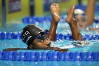 Simone Manuel looks up at her time after swimming in the women's 50 freestyle during wave 2 of the U.S. Olympic Swim Trials on Saturday, June 19, 2021, in Omaha, Neb. (AP Photo/Jeff Roberson)