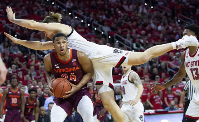 "Virginia Tech's <a class=""link rapid-noclick-resp"" href=""/ncaab/players/131643/"" data-ylk=""slk:Kerry Blackshear Jr."">Kerry Blackshear Jr.</a> (24) is fouled by North Carolina State's <a class=""link rapid-noclick-resp"" href=""/ncaab/players/132390/"" data-ylk=""slk:Wyatt Walker"">Wyatt Walker</a>, right, on Saturday in Raleigh, N.C. (AP Photo/Ben McKeown)"