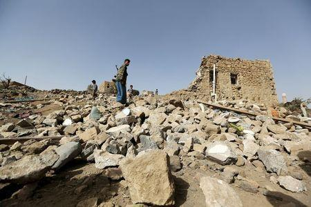 A man walks on the rubble of a house destroyed by an air strike in the Bait Rejal village west of Yemen's capital Sanaa April 7, 2015. REUTERS/Khaled Abdullah