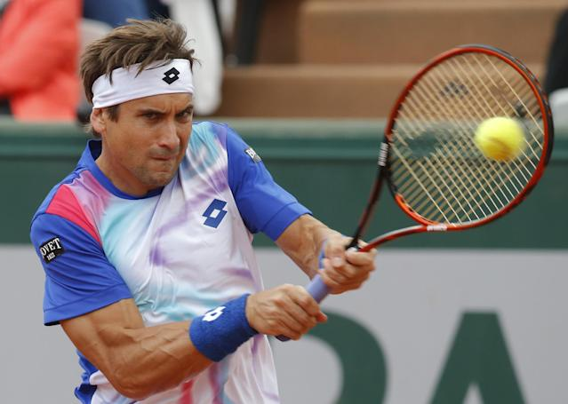 Spain's David Ferrer returns the ball to Italy's Simone Bolelli during their second round match of the French Open tennis tournament at the Roland Garros stadium, in Paris, France, Thursday, May 29, 2014. (AP Photo/Michel Euler)