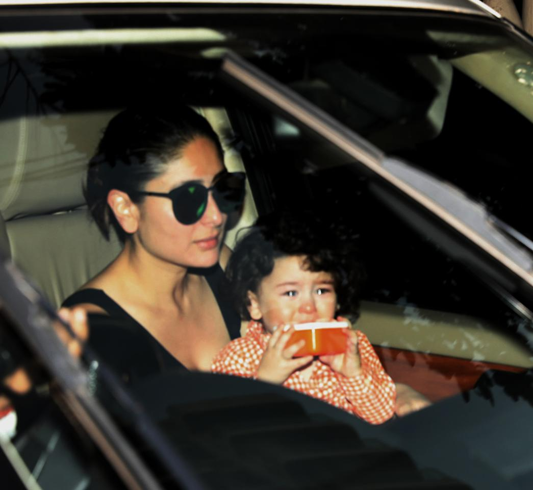 <p>Black oversized glasses with a green tint doesn't seem to impress Taimur, but we beg to differ. </p>