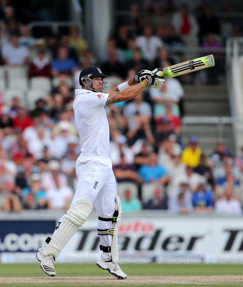 England batsman Kevin Pietersen hits a 4 to get his 100 during day three of the Third Investec Ashes test match at Old Trafford Cricket Ground, Manchester.
