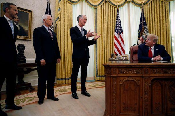 PHOTO: Daniel O'Day, CEO of Gillead Sciences Inc., speaks during a meeting with President Donald Trump in the Oval Office of the White House, May 1, 2020, in Washington, as Vice President Mike Pence and Adam Boehler watch. (Alex Brandon/AP)