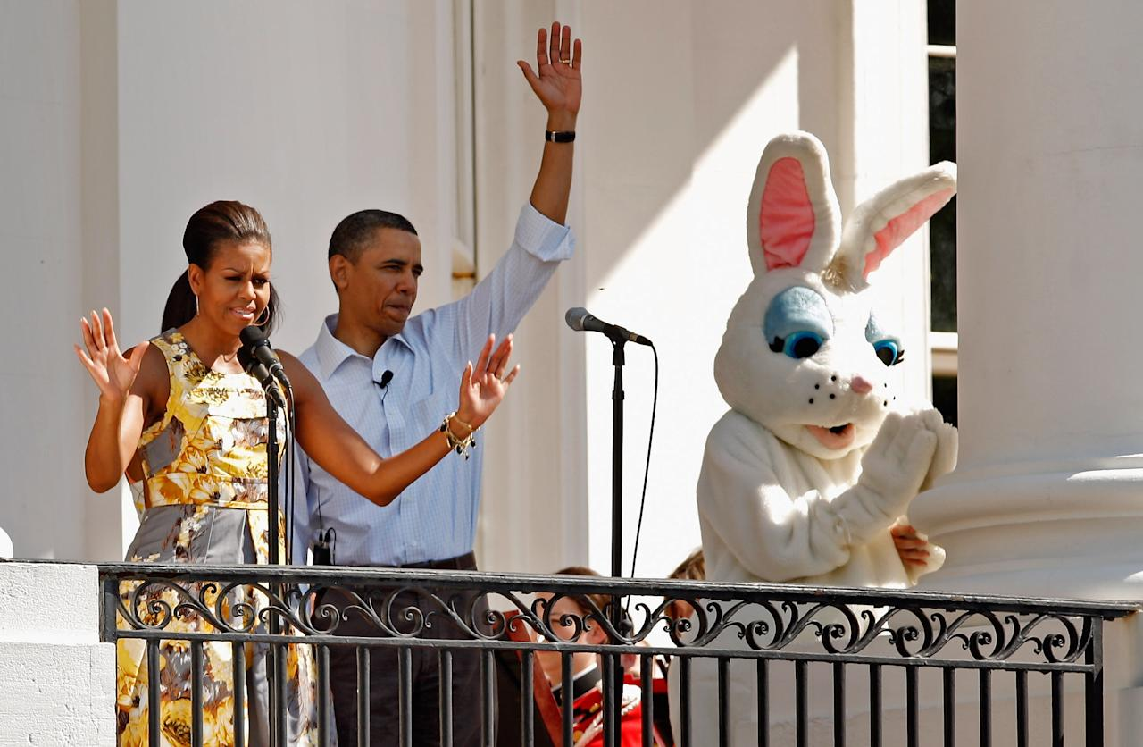 WASHINGTON, DC - APRIL 25:  (AFP OUT) U.S. first lady Michelle Obama (L) and President Barack Obama officially open the White House Easter Egg Roll on the South Lawn of the White House April 25, 2011 in Washington, DC. About 30,000 people are expected to attend the 133-year-old tradition of rolling colored eggs down the White House lawn.  (Photo by Chip Somodevilla/Getty Images)