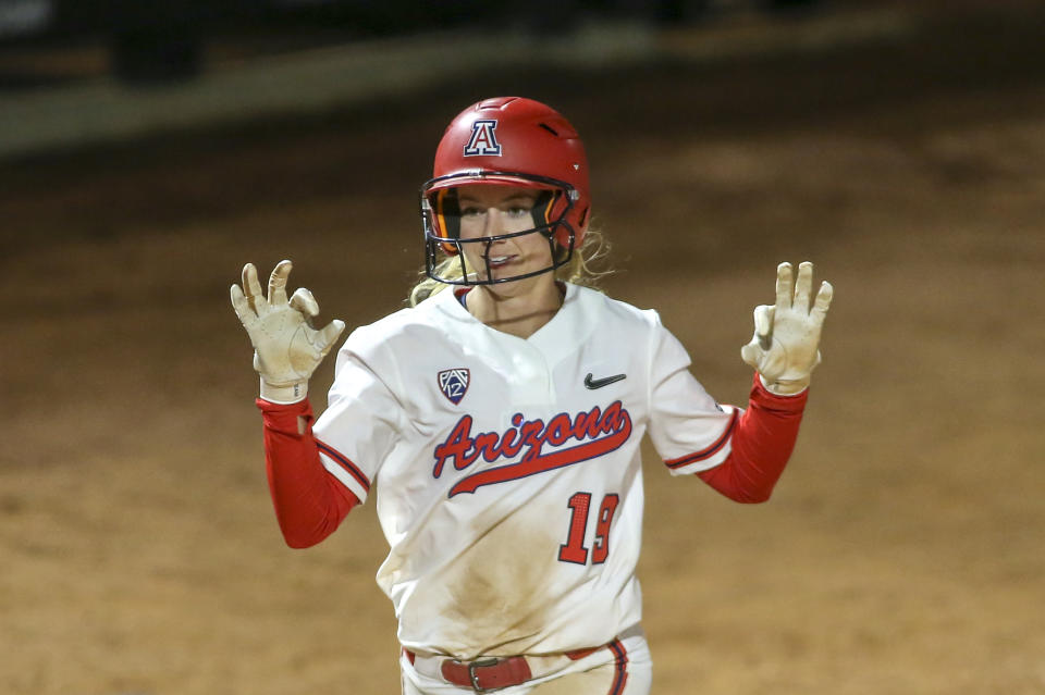 Arizona Wildcats infielder Jessie Harper (19) celebrates a home run during a college softball game between the UIC Flames and the Arizona Wildcats on February 15, 2019, at Hillenbrand Stadium in Tucson, AZ. (Photo by Jacob Snow/Icon Sportswire via Getty Images)