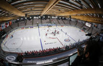 Play gets underway as Canada plays Finland during the first period of an IIHF women's hockey championship game in Calgary, Alberta, Friday, Aug. 20, 2021. (Jeff McIntosh/The Canadian Press via AP)
