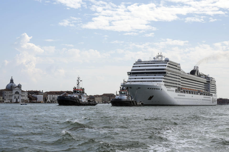 The MSC Orchestra cruise ship leaves Venice, Italy, Saturday, June 5, 2021. The 92,409-ton, 16-deck MSC Orchestra cruise ship, the first cruise ship leaving Venice since the pandemic, is set to depart Saturday amid protests by activists demanding that the enormous ships be permanently rerouted out the fragile lagoon, especially Giudecca Canal through the city's historic center, due to environmental and safety risks. The ship passed two groups of protesters: pro-cruise advocates whose jobs depend on the industry as well as protesters who have been campaigning for years to get cruise ships out of the lagoon. (AP Photo/Antonio Calanni)