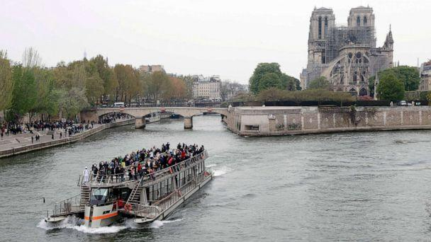 PHOTO: A tourist boat sails on the river Seine near Notre-Dame-de-Paris on April 16, 2019 in the aftermath of a fire that devastated the cathedral. (Thomas Samson/AFP/Getty Images)