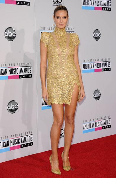 <b>Best dressed: Heidi Klum</b><br><br>The supermodel showed off her long legs in a gold lace Alexandre Vauthier AW12 couture dress, teamed with Lorraine Schwartz jewels and gold encrusted Louboutins.