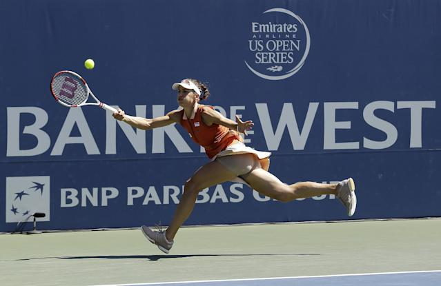 Andrea Petkovic, from Germany, chases down the ball during the second set of a semifinal against Serena Williams, of the United States, in the Bank of the West Classic tennis tournament in Stanford, Calif., Saturday, Aug. 2, 2014. Williams won 7-5, 6-0. (AP Photo/Jeff Chiu)