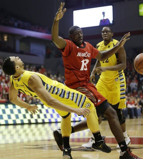 Cincinnati center Cheikh Mbodj (13) charges into Marquette guard Trent Lockett, left, in the first half of an NCAA college basketball game, Saturday, Jan. 19, 2013, in Cincinnati. (AP Photo/Al Behrman)
