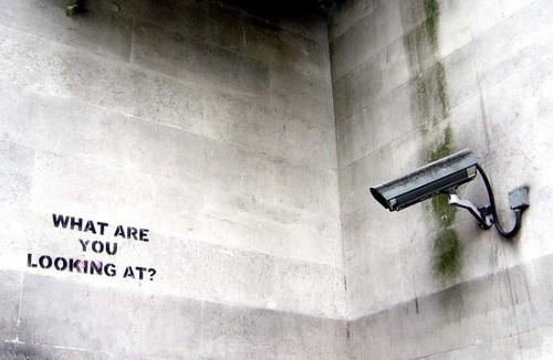 security camera pointing at the words 'what are you looking at?'