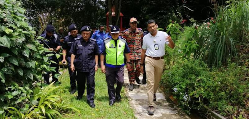 Datuk Mazlan Mansor being shown around The Dusun resort by Negri Sembilan deputy police chief Datuk Mohamad Mat Yusop (left) and International Relations IGP Secretariat Office ACP Nik Ezanee Mohd Faisal (right) August 11, 2019. — Picture courtesy of Royal Malaysian Police