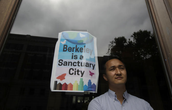 """Berkeley councilman Rigel Robinson poses for photos inside the Martin Luther King Jr. Civic Center building in Berkeley, Calif., Thursday, July 18, 2019. Soon students in Berkeley, California will have to pledge to """"collegiate Greek system residences"""" instead of sororities or fraternities and city workers will have to refer to manholes as """"maintenance holes."""" Officials in the liberal city this week passed an ordinance to replace some terms with gender-neutral words in the city code. (AP Photo/Jeff Chiu)"""