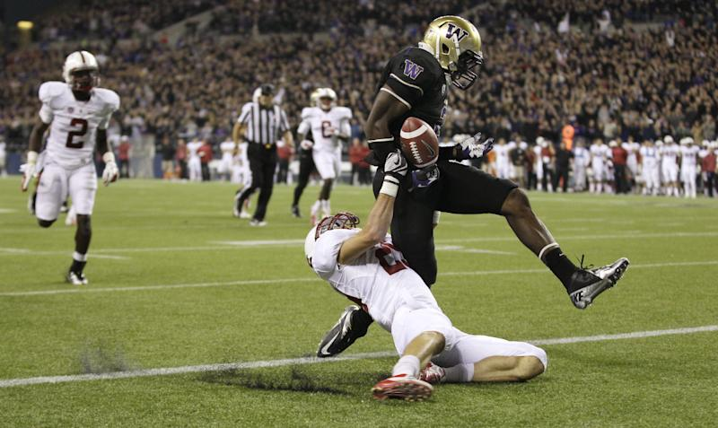 Washington's Kasen Williams, right, scores a touchdown as Stanford's Harold Bernard knocks the ball loose after Williams crosses the goal line, in the second half of an NCAA college football game, Thursday, Sept. 27, 2012, in Seattle. Washington beat Stanford. (AP Photo/Ted S. Warren)